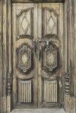 Old  wooden door from medieval era found in Alsace region of Fran. Old wooden door from medieval era found in Alsace region of France Stock Photos