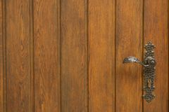 Old wooden door from medieval era. Textured background. stock photos