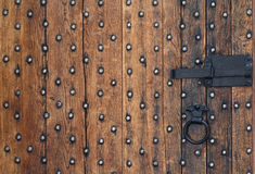 Old wooden door and a metal bolt Stock Images