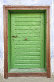 Old wooden door with a metal handle Royalty Free Stock Photos