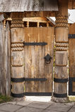 Old wooden door on metal hinges Stock Photography