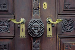 Old wooden door with metal knocker Royalty Free Stock Photo