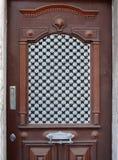 Ornate door. Old wooden door with metal ornaments Royalty Free Stock Images