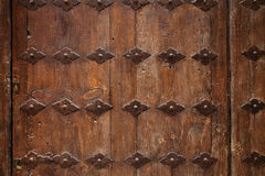 Old wooden door with metal ornate background Stock Photo