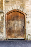 Old wooden door with metal studs Stock Photos
