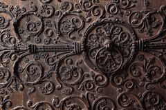 Old wooden door with a metallic pattern. Close-up. Notre Dame, Paris, France. Septemder 06, 2017 stock photography