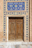 Old wooden door with mosaic in the Central Asian style Stock Photo