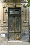 Old wooden door. The old not painted door decorated with carvings stock photos