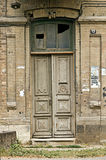 Old wooden door. The old not painted door decorated with carvings royalty free stock photography
