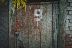 Old wooden door with the number in the evening. Royalty Free Stock Photography