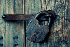 An old wooden door with an old lock. Royalty Free Stock Image
