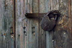 An old wooden door with an old lock. Royalty Free Stock Photo