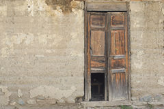 Old wooden Door in Old wall. Colonial Latin America royalty free stock image