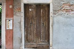 Old wooden door and old wall. Architectural details. Background stock photos