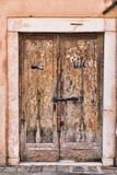 Old wooden door. In a stone house Italian royalty free stock photos