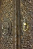 Old wooden door with ornaments Royalty Free Stock Image