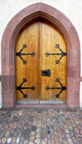 Old wooden door with ornements Royalty Free Stock Photography