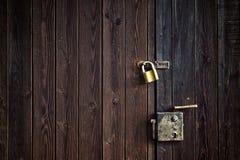 Old wooden door with padlock Stock Images