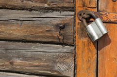 Old wooden door with padlock,  fragment Stock Photography