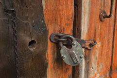 Old wooden door with padlock,  fragment Stock Image