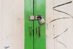 Old wooden door with padlock Royalty Free Stock Photo