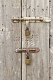 Old wooden door with padlocks. Stock Photo