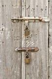 Old wooden door with padlocks. Stock Photo