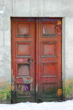 Old Wooden Door Painted in dark red color. Vintage Weathered Entry Stock Photo