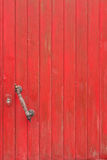 Old wooden door, painted in red paint Royalty Free Stock Images