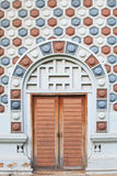 Old wooden door and pattern wall of brick Stock Photos