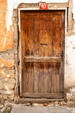 Old Wooden Door. This is a picture of an old wooden, very rustic, brown door Royalty Free Stock Photography