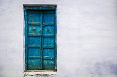 Old Blue Door. An old wooden door in Pushkar, India Royalty Free Stock Image