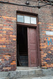 Old wooden door. In red brick house Royalty Free Stock Photo
