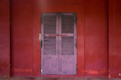Old wooden door on the red wall. Of the public historic building in Chantaburi, Thailand Royalty Free Stock Images