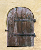Wooden door in wall, Vecriga (Old Town) - Riga - Latvia Royalty Free Stock Images