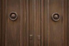 Old wooden door with round door handles Stock Photography