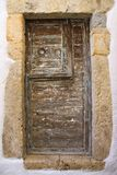 Old wooden door with round metal handle stock photos