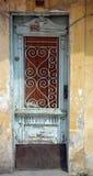 Old wooden door in ruin Stock Photography