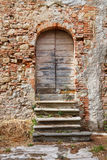 Old wooden door. Of a run down house in Tuscany, Italy Stock Photos