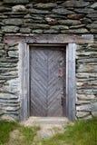 Old Wooden Door in Rural House. Old Wooden Door in Rural Stone House stock photo