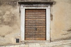 Old wooden door in rural italian house, Tuscany, Italy. stock photo
