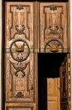 The old wooden door. Russia. Saint-Petersburg. Old wooden door in Church of St. Catherine on Nevsky Prospekt in Saint Petersburg. Decorative crown carving Stock Image