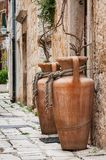 Two amphoras in the narrow mediterranean street stock photography