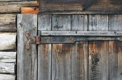 Old wooden door with rusty fastening stock image