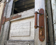 Old wooden door with rusty knob Stock Photo