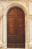 The old wooden door seen in Siena Stock Images