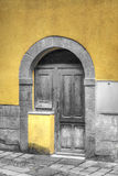 Old wooden door with selective desaturation Stock Photo