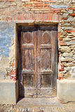 Old wooden door. Serralunga D'Alba, Italy. Stock Images