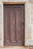 Old wooden door set in stone Stock Photos