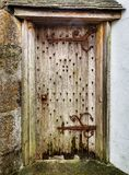 Old Wooden Door with Rusty Hinges and Handle royalty free stock image